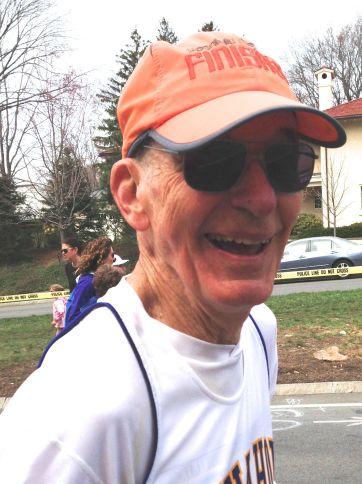 Kit running hard at mile 20.5 of the Boston Marathon