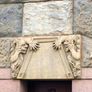 Finnish art deco trolls seen on a period building