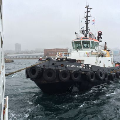 A tugboat puling our ship around so it can leave the harbor in Halifax