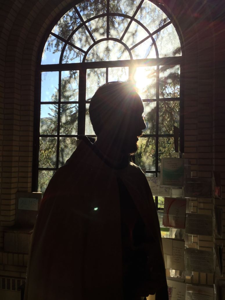 A Benedictine monk (Aaron) in the monastery bookstore.